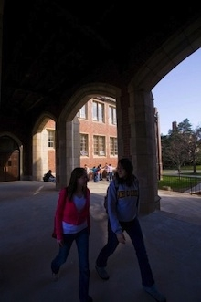 two college students walking in the college courtyard