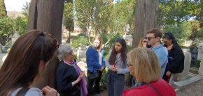 JCU students visiting Shelley's tomb in Italy listening to a British traveller.