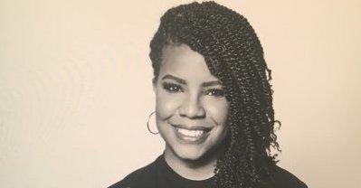 Headshot of activist April Reign.