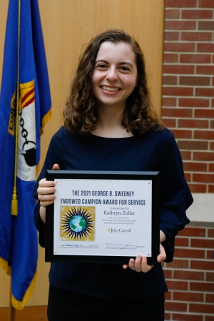 Kathryn Zoller '23 holding the Campion Award Certificate