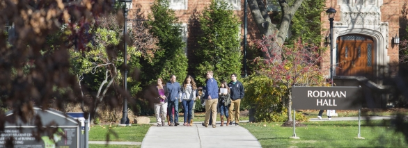 Group starting campus tour outside of Rodman Hall