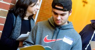 student reading JCU booklet