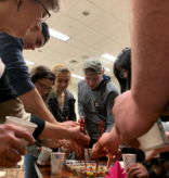 Students practice chopstick skills by picking up jelly beans