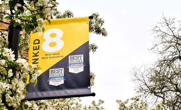 Picture of a pole banner on campus highlight John Carroll University's #8 ranking for Best Value and #8 Most Innovative Schools in U.S. News & World Report's 2019 Regional Universities Midwest region