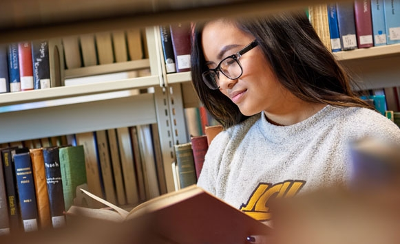Female student studying in the library