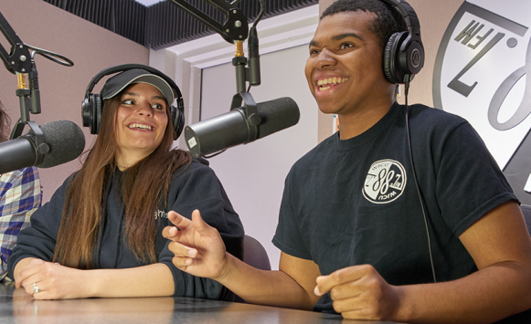 students at radio station with microphones