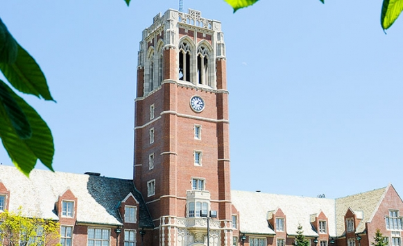 picture of clock tower with leaves