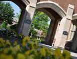 Arches between the Administrative Building and Boler Building with spring flowers in bloom