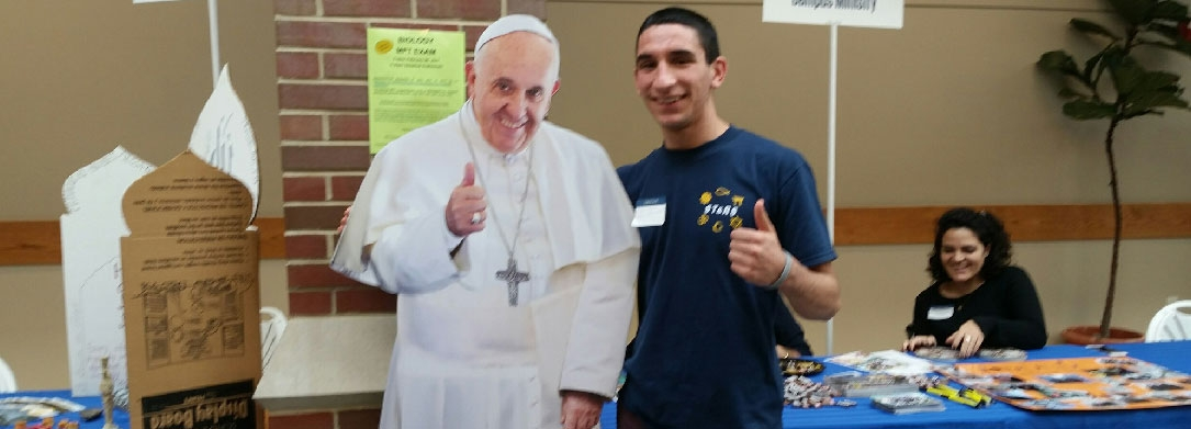 photo if a teenager with a Pope Francis cutout