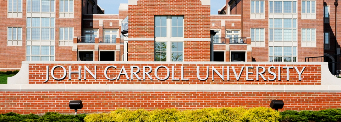 John Carroll University sign in front of campus building