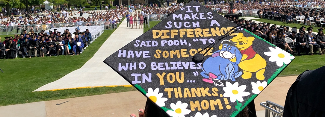 "Decorated graduation cap featuring Winnie the Pooh and Eeyore that reads, ""It makes such a difference,"" said Pooh, ""to have someone who believes in you ..."" Thanks, Mom!"