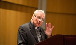 Archbishop Fitzgerald gives his lecture in Donahue Auditorium.