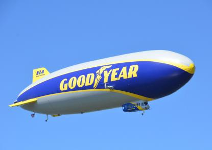 Wingfoot One flies against a scenic blue sky