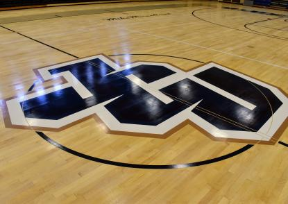 The center court logo in the DeCarlo Center - the new JCU athletics logo