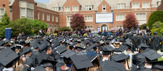 Banner image of a crowd of JCU graduates