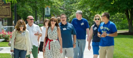 Group of JCU alumni walking on campus