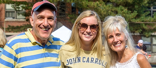 Parents at Homecoming & Family Weekend tailgate with their student
